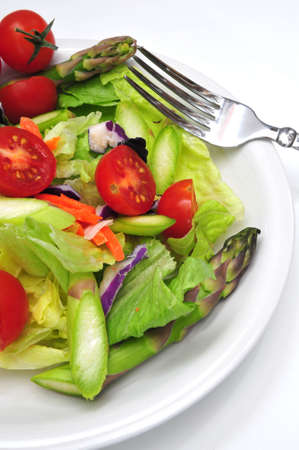appetize: Dinner salad with assorted vegetable on a light background
