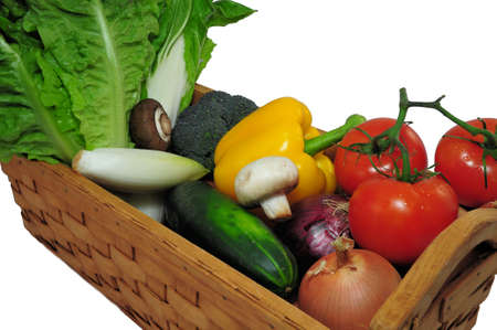 vegtables: Assorted vegtables in a wooden basket on a light background Stock Photo