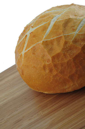 Round loaf of fresh sourdough bread on a cutting board