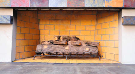 outdoor fireplace: Natural gas fired outdoor fireplace with ceramic logs on a steel grate Stock Photo