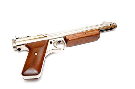 pellet gun: A .177 caliber pellet gun also known as an air gun on a light colored bcakground.
