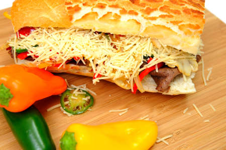 Steak and Sweet Pepper Sandwich with mild jalapeno chili and grated asiago cheese photo