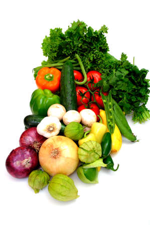 produces: Fresh produce on a white background including red and yellow onions, tomatillos, cucumber, lettuce, cilatro, peas, sweet and hot peppers, tomatoes, zuchinni and summer squash Stock Photo