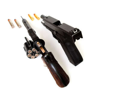 38 caliber: A 38 caliber revolver and a semi-auto pistol with ammunition showing on a white background Stock Photo