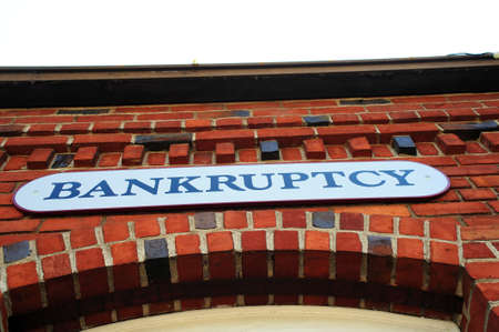 bad fortune: Bankruptcy sign on the front of a red brick building Stock Photo