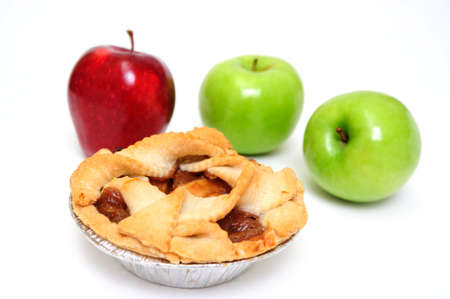 Apple pie for one on a white background with 2 green granny smith and one red apple