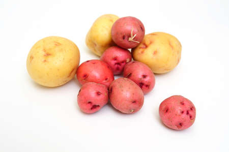Red and white new small potatoes isolated on a white background