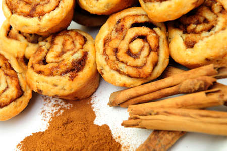 Powdered and stick cinnamon with freah baked mini cinnamon rolls photo