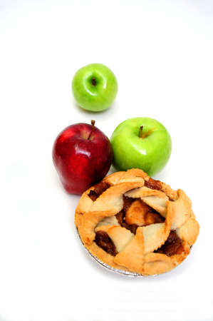 Apple pie for one on a white background with 2 green granny smith and one red apple photo