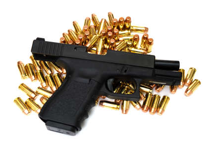 A semi automatic pistol with many .40 caliber brass cartridges. The weapon is locked open. Stock Photo - 5749584