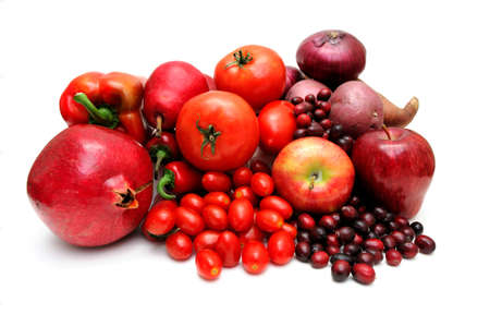Vegetables and fruit all of red coloring including pomegranate, red pears, large and cherry tomatoes, apples, sweet potato, chilie peppers and cranberries. Stock Photo - 5997407