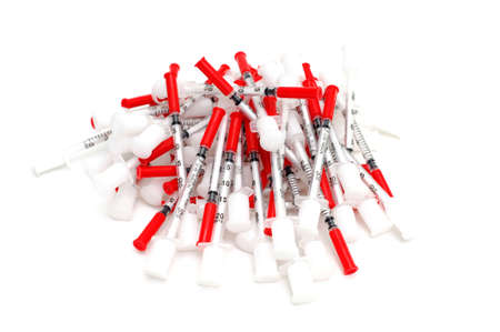 Used disposable syringe needles that had been used for Insulin injections isolated on white Stock fotó