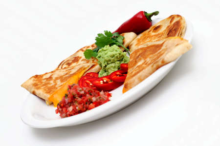 Cheddar cheese quesadillas with fresh tomato salsa, guacamole and a sliced red chili with a cilantro and pepper garnish.