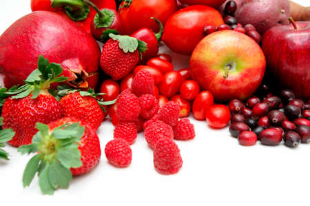 Different fruits that are all red in color including strawberries, raspberries, apples, cranberries and more. photo