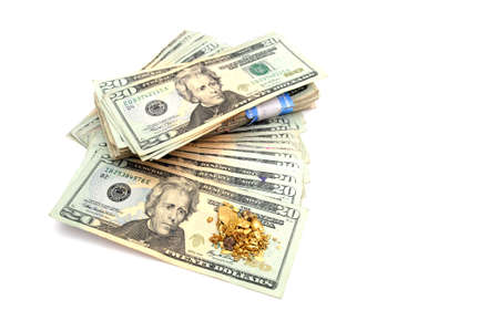 raw gold: A stack of American twenty dollar bills with an ounce of raw gold nuggets on top Stock Photo