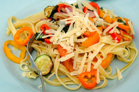 Fettuccine with vegetables sautéed in olive oil with sweet peppers, sliced zucchini squash with grated parmesan cheese