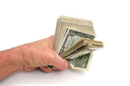白い背景に一握りの米国 1 ドル札を保持くいしばられた握りこぶし
