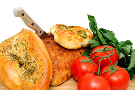 unsliced: A loaf of old style unsliced bread with  Focaccia topped with Italian herbs and jalapeno with cheddar cheese. Stock Photo