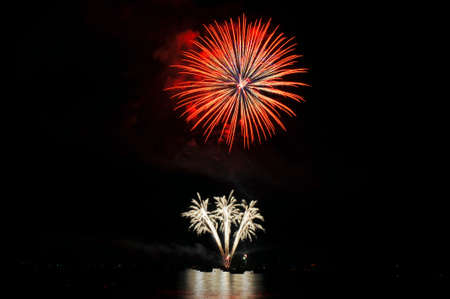 Colorful nighttime fireworks against a solid black sky over Lake Tahoe on the fourth of July holiday 2010