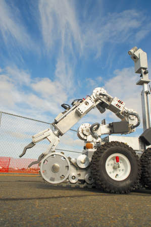 controlled: Remote controlled robot used by the military and police for inspection of a possible bomb or dangerous situation