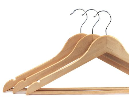 Wooden hangers isolated on a white background photo