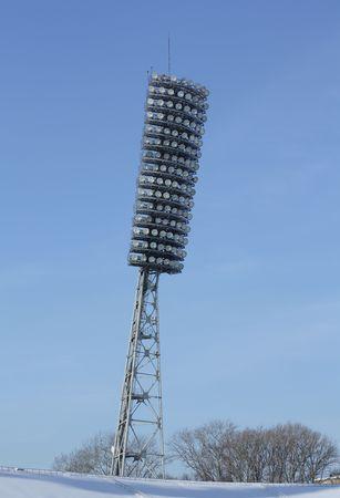 Lamp stadium on a clear blue sky photo