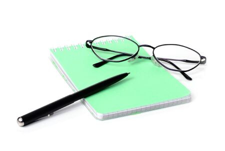 Glasses,pen and a notebook on a white background Stock Photo - 6763081