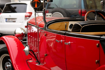 old red vintage car in downtown of Prague photo