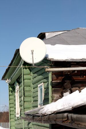 satellite dish at the old house in the village photo