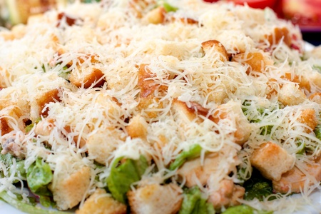 sprinkled: Caesar salad on a plate sprinkled with grated cheese