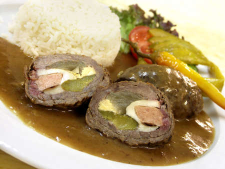Czech speciality - spanish bird with rice - beef roll stuffed with eggs, cucumbers, salami and bacon