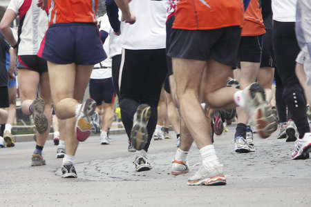 Long distance runners in closeup, shallow focus Stock Photo