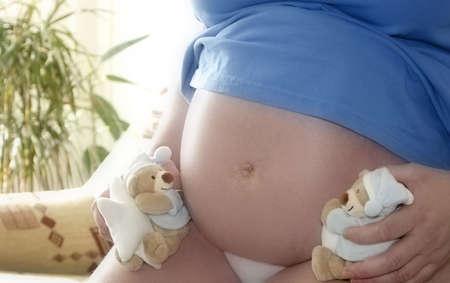 plushy: Pregnant woman with plushy teddy bear - 36 week gravidity Stock Photo