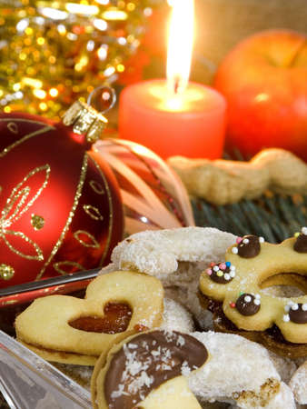 Christmas atmosphere - candle, sweets and Christmas decorations Stock Photo