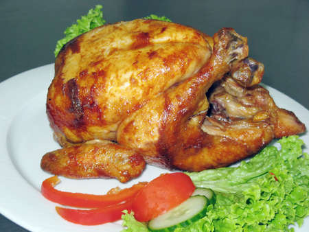 Tasty Crispy Roast Chicken on white plate Stock Photo - 3293703