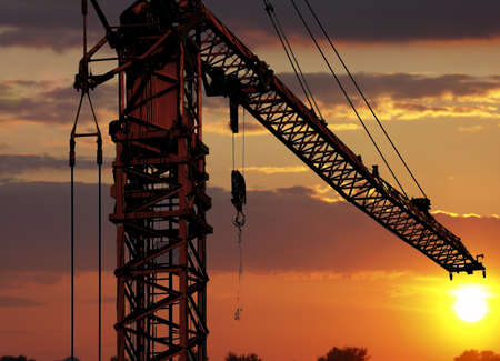 Detail crane with sunset photo