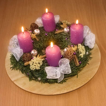 Christmas wreath with violet candles photo