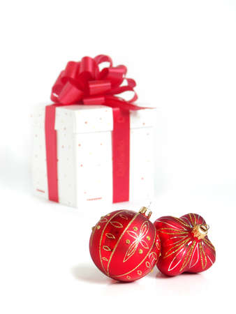 Christmas ball and gift box with red ribbon on white background photo