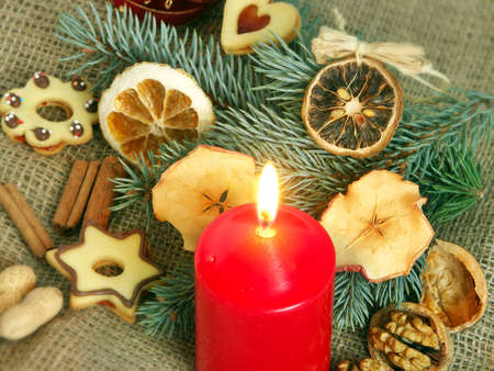 Christmas still life in red candle and dry fruit Stock Photo - 3602476