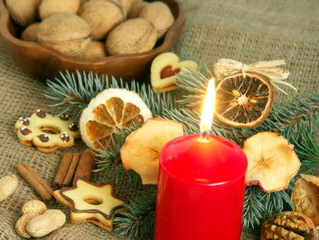 Christmas still life in red candle and dry fruit Stock Photo - 3602468