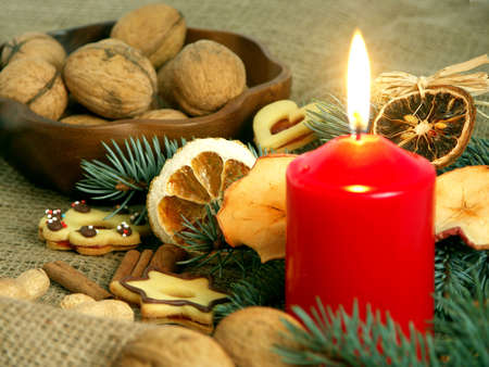 Christmas still life in red candle and dry fruit Stock Photo - 3602466