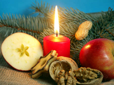 firry: Christmas still life in red candle and dry fruit