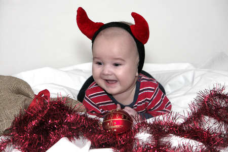 picture of smale baby boy with devilish horn photo