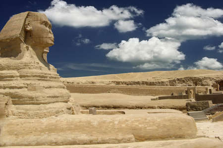 Symbol Egypt's - Sphinx with summer blue sky and clouds in Giza, Cairo