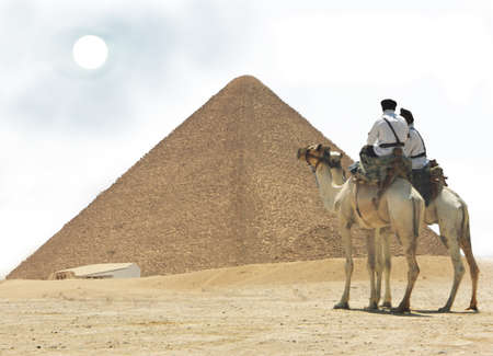 pyramid peak: Egypt -  Cairo, Giza - two cops on camel