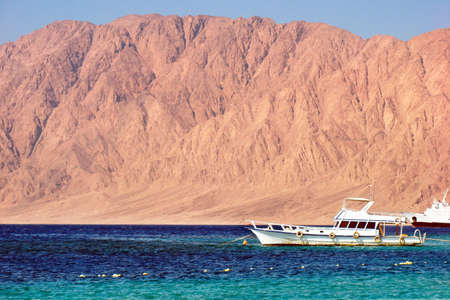reds: Egypt Nuweiba - beach with mountains and boats at Reds sea Stock Photo