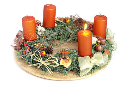 Christmas - wreath from fresh twigs and cones with four candle photo