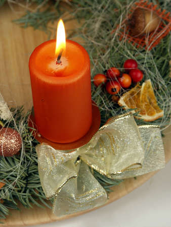 advent candles: Christmas - wreath from fresh twigs and cones with one candle Stock Photo