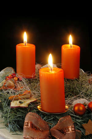 Christmas - wreath from fresh twigs and cones with four candle Stock Photo - 5221025