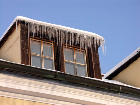 two old windows with icicles photo
